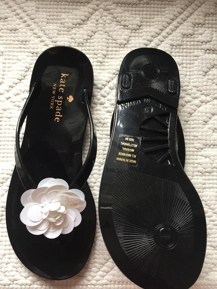 a67783f05536 Kate Spade Black Fiorina with White Flower Rubber Flip Flops Sandals ...