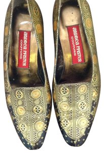 Andrea Pfister Couture Dark brown with gold toolwork. Flats