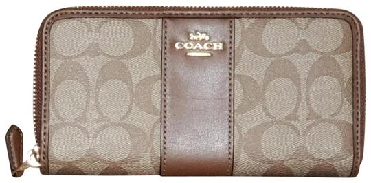 Preload https://img-static.tradesy.com/item/23593868/coach-brown-accordion-zip-in-signature-f-54007-54630-wallet-0-2-540-540.jpg