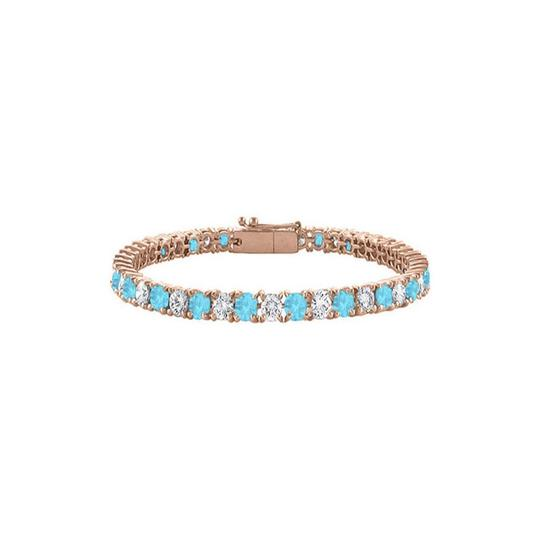 Preload https://img-static.tradesy.com/item/23595722/blue-created-topaz-and-cubic-zirconia-tennis-rose-vermeil-bracelet-0-0-540-540.jpg