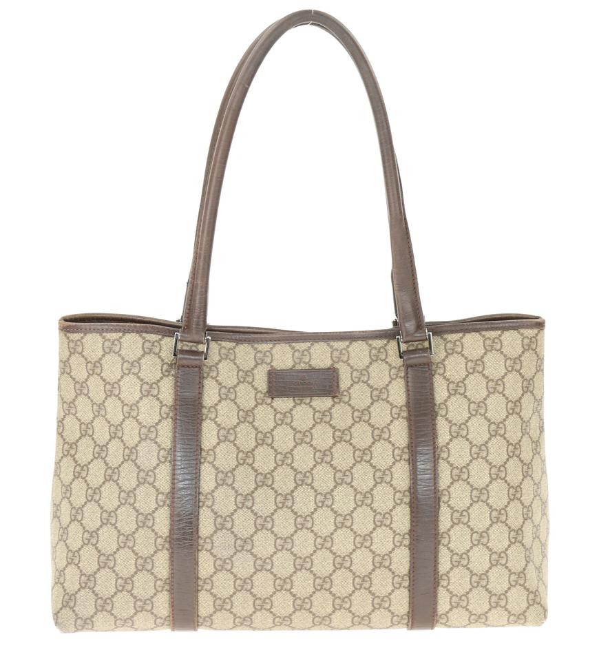 32f154ca39a9 Gucci East-west Gg Brown Coated Canvas Tote - Tradesy
