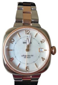 Shinola gold and silver tone watch