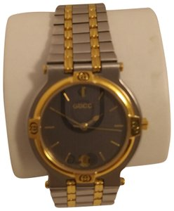 Gucci Gucci 9000 M stainless and gold plated swiss made watch