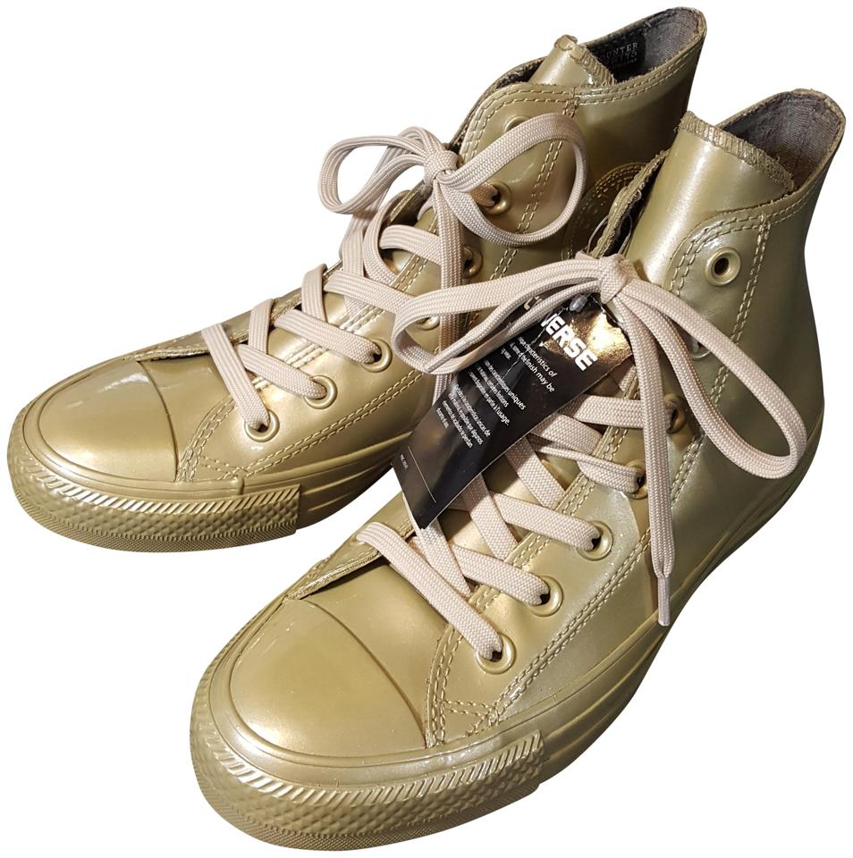 550d312c5aad Converse Gold All Star Chuck Taylor Hi Top Sneakers. Size  US 7 ...