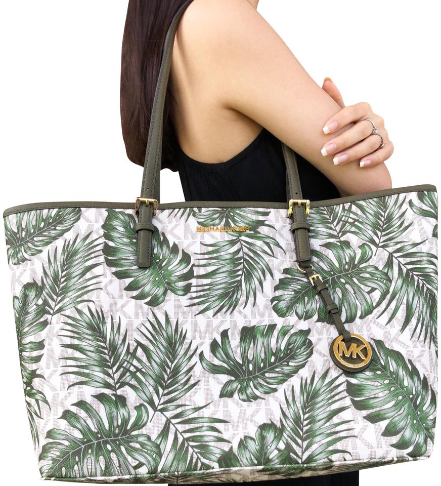 55a3e22845db Michael Kors Carryall Jet Set Travel Large Vanilla Mk Palm Leaves ...