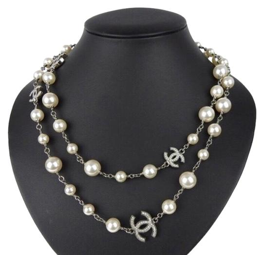 Preload https://img-static.tradesy.com/item/23625942/chanel-silver-long-pearl-with-5-rhinestone-crystals-cc-logo-necklace-0-10-540-540.jpg