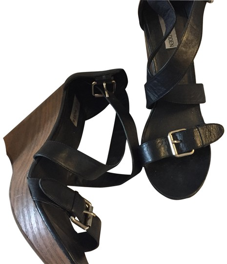 Preload https://img-static.tradesy.com/item/23627735/steve-madden-wooden-wedges-with-black-straps-sandals-size-us-95-regular-m-b-0-1-540-540.jpg