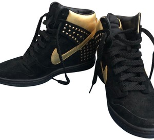 Nike black and gold. Athletic