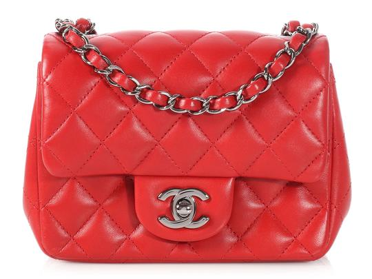 Preload https://item1.tradesy.com/images/chanel-flap-mini-classic-quilted-red-lambskin-leather-cross-body-bag-23629215-0-0.jpg?width=440&height=440