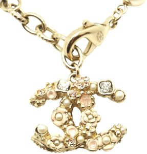 Chanel CC pearls camellia flowers charms inlay gold bracelet