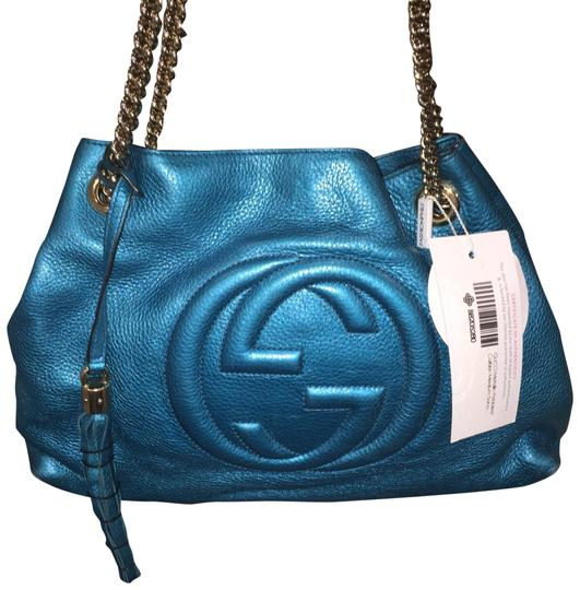 Preload https://img-static.tradesy.com/item/23632168/gucci-soho-limited-edition-metallic-aqua-blue-teal-pebbled-leather-tote-0-2-540-540.jpg