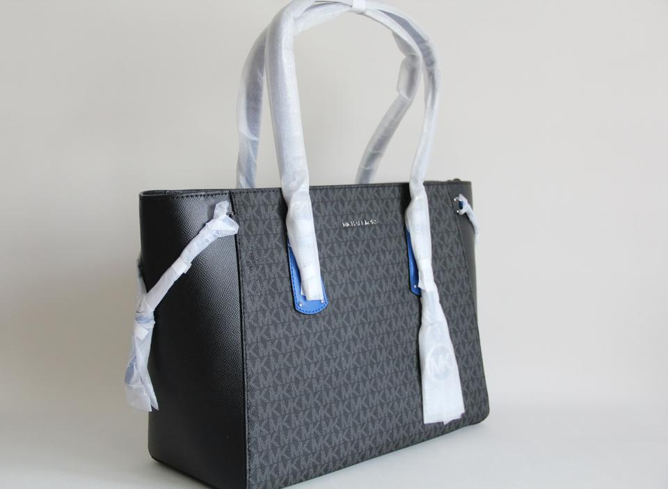 24d9ea495ffb Michael Kors Voyager Multi Function Black and Electric Blue Signature Pvc Leather  Tote - Tradesy