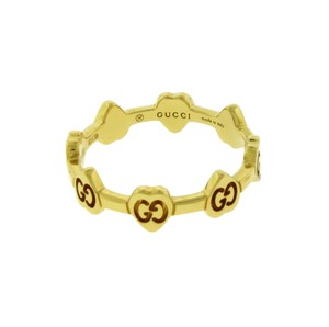 Gucci Gucci logo thin band ring in 18k yellow gold new in box Size 8.5