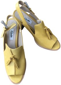 Yellow Clarks Sandals - Up to 90% off at Tradesy