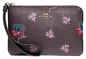 Coach Petal 889532150519 Light Pink F53429 Wristlet in red