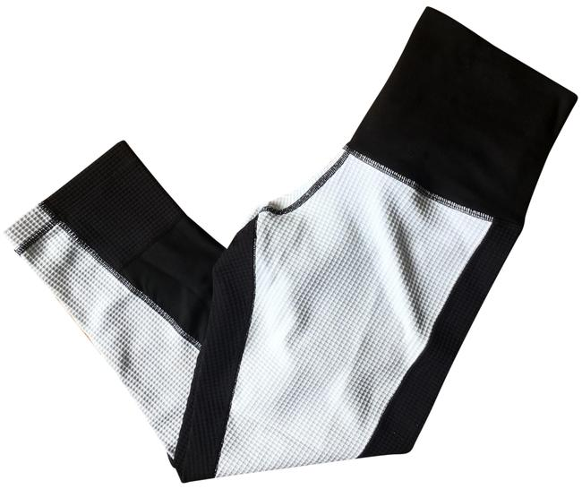 Preload https://item2.tradesy.com/images/white-black-color-block-cropped-legging-activewear-capriscrops-size-8-m-23660721-0-1.jpg?width=400&height=650