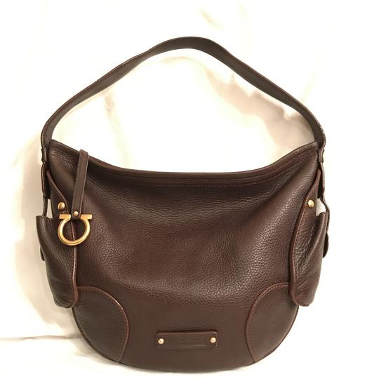 Preload https://item3.tradesy.com/images/salvatore-ferragamo-full-grain-brown-gold-leather-hobo-bag-23660867-0-0.jpg?width=440&height=440