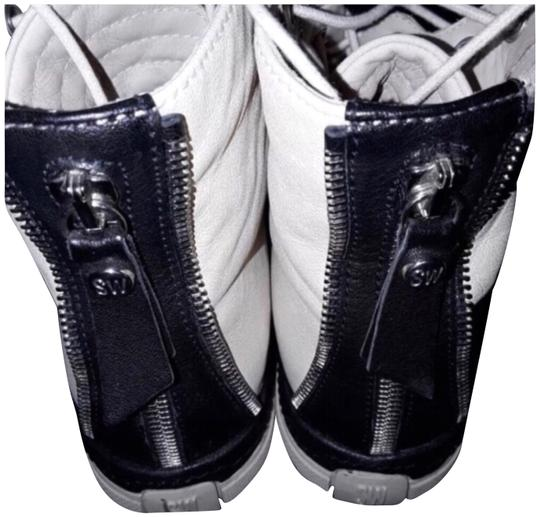 Preload https://item1.tradesy.com/images/stuart-weitzman-black-white-leather-zipit-vecchio-nappa-high-top-sneakers-sneakers-size-us-6-regular-23660960-0-1.jpg?width=440&height=440
