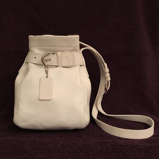 Preload https://item2.tradesy.com/images/coach-rare-color-bucket-cinch-4156-white-silver-leather-cross-body-bag-23661091-0-0.jpg?width=440&height=440
