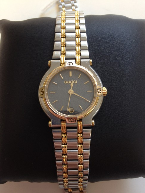 Item - Stainless Steel and 18 Carat Gold 9000l Ladie's Wrist Watch