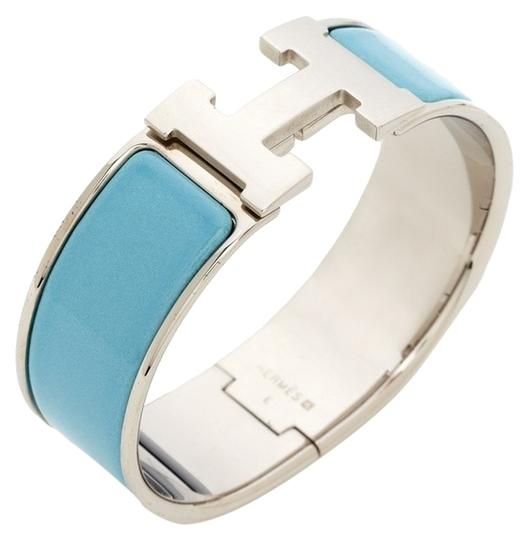 Preload https://item3.tradesy.com/images/hermes-palladium-and-baby-blue-enamel-herms-wide-clic-clac-bracelet-2367337-0-0.jpg?width=440&height=440
