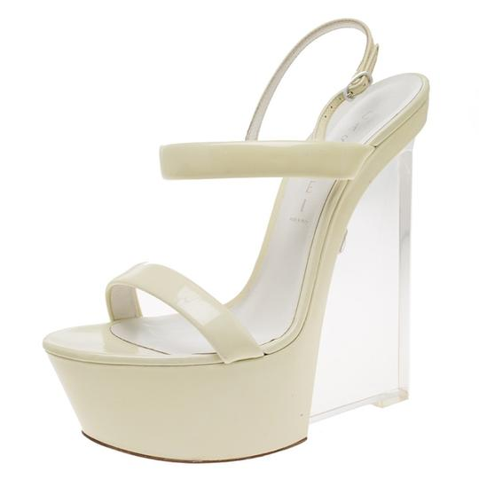 Preload https://img-static.tradesy.com/item/23679453/casadei-cream-patent-leather-plexiglass-slingback-sandals-wedges-size-eu-39-approx-us-9-regular-m-b-0-0-540-540.jpg