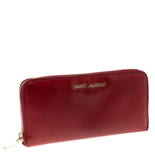 Preload https://img-static.tradesy.com/item/23679471/saint-laurent-red-textured-patent-leather-zip-around-wallet-0-1-540-540.jpg