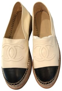 Chanel ivory and black Flats