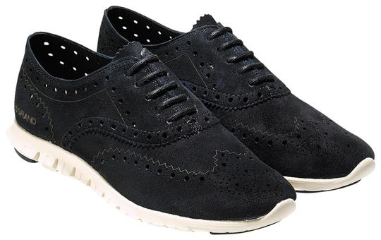 Preload https://img-static.tradesy.com/item/23690217/cole-haan-black-leather-zerogrand-wingtip-oxford-flats-size-us-7-regular-m-b-0-1-540-540.jpg