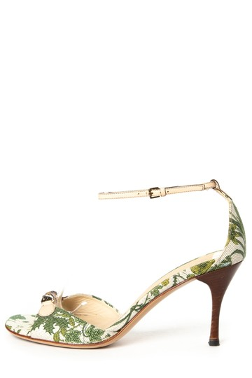 Preload https://img-static.tradesy.com/item/23693329/gucci-white-and-green-floral-bamboo-sandals-size-us-65-regular-m-b-0-0-540-540.jpg
