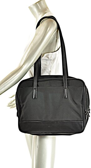 Preload https://img-static.tradesy.com/item/23693550/tumi-leather-trim-briefcase-tote-with-organizer-black-nylon-laptop-bag-0-1-540-540.jpg