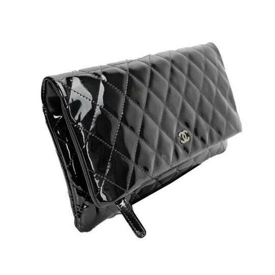 Preload https://item2.tradesy.com/images/chanel-classic-flap-14b-black-patent-leather-clutch-23706276-0-6.jpg?width=440&height=440