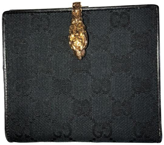 Preload https://img-static.tradesy.com/item/23707009/gucci-black-with-gold-accent-wallet-0-1-540-540.jpg