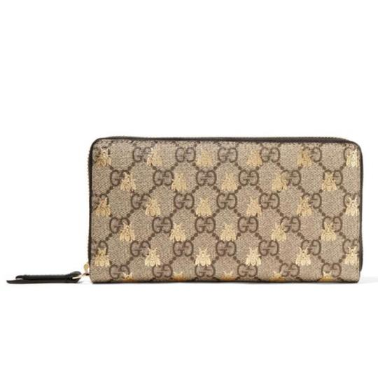 402bfd665e5 Gucci printed logo canvas leather zip around wallet Image 0 ...