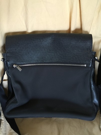 Louis Vuitton Taiga Leather Adjustable Strap Silver Hardware Zippered Pocket Two Pockets Front Under The Flap Very Rare Satchel in black