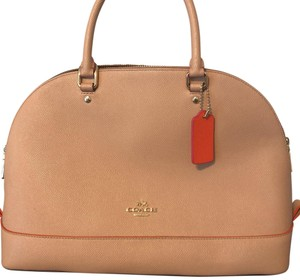Coach Satchel in nude in color with bright orange and pink accents