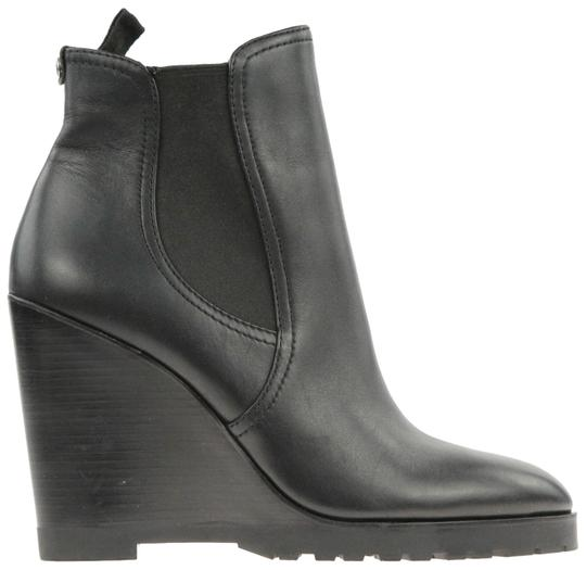 Preload https://img-static.tradesy.com/item/23719692/michael-michael-kors-black-leather-wedge-bootsbooties-size-us-9-regular-m-b-0-3-540-540.jpg