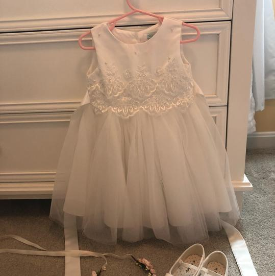 Preload https://img-static.tradesy.com/item/23719944/blossom-ivorywhite-tulle-with-lace-flower-girl-traditional-bridesmaidmob-dress-size-2-xs-0-0-540-540.jpg