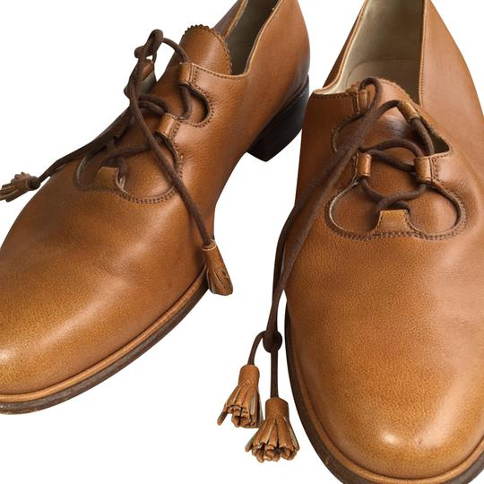Preload https://img-static.tradesy.com/item/23720435/carmel-vintage-italian-leather-tie-up-loafer-flats-size-us-10-regular-m-b-0-1-540-540.jpg