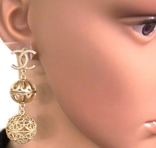 Chanel Rare and Exquisite CC cutout ball gold dangle pierced stud earrings Image 1