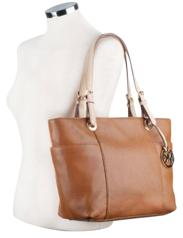 07cecf43b2cc Michael Kors Jet Set Item East West Snap Pocket Jet Set Travel Tote in brown  Image ...