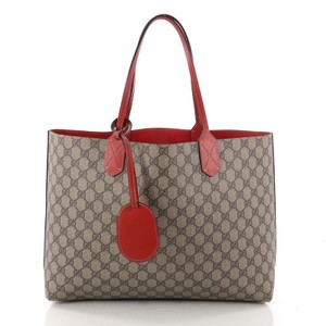 9c7e3655a31ed8 Added to Shopping Bag. Gucci Reversible Tote in beige and red. Gucci  Reversible Gg Print Medium Beige and Red Leather Tote