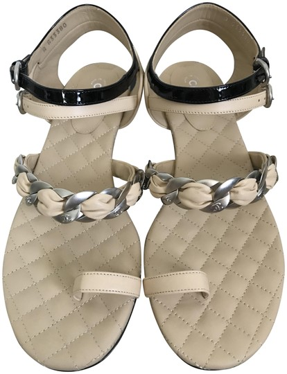 Preload https://img-static.tradesy.com/item/23739549/chanel-beige-black-logo-chain-link-ankle-strap-quilted-flat-sandals-size-eu-38-approx-us-8-regular-m-0-1-540-540.jpg