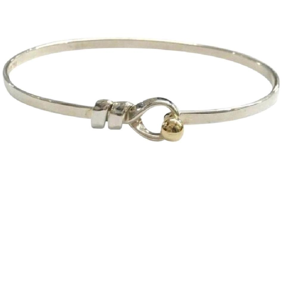 637d62f1e Tiffany & Co. 18 Karat Yellow Gold and Sterling Silver Love Knot ...