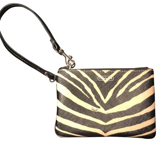 Preload https://img-static.tradesy.com/item/23751940/coach-zebra-print-black-white-leather-wristlet-0-1-540-540.jpg