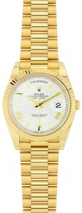 Rolex Rolex Day Date 40 President Yellow Gold Champagne Dial 228238