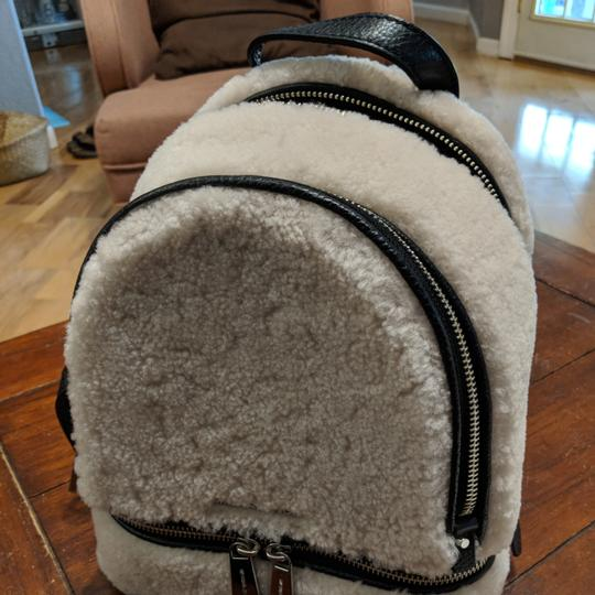 Preload https://item1.tradesy.com/images/michael-kors-rhea-leather-medium-cream-and-black-shearling-wool-backpack-23755400-0-1.jpg?width=440&height=440