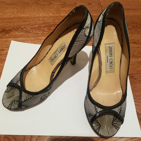 Preload https://item3.tradesy.com/images/jimmy-choo-white-and-black-open-toe-heels-blackwhite-satin-with-leather-vero-cuoio-pumps-size-us-6-r-23755457-0-0.jpg?width=440&height=440