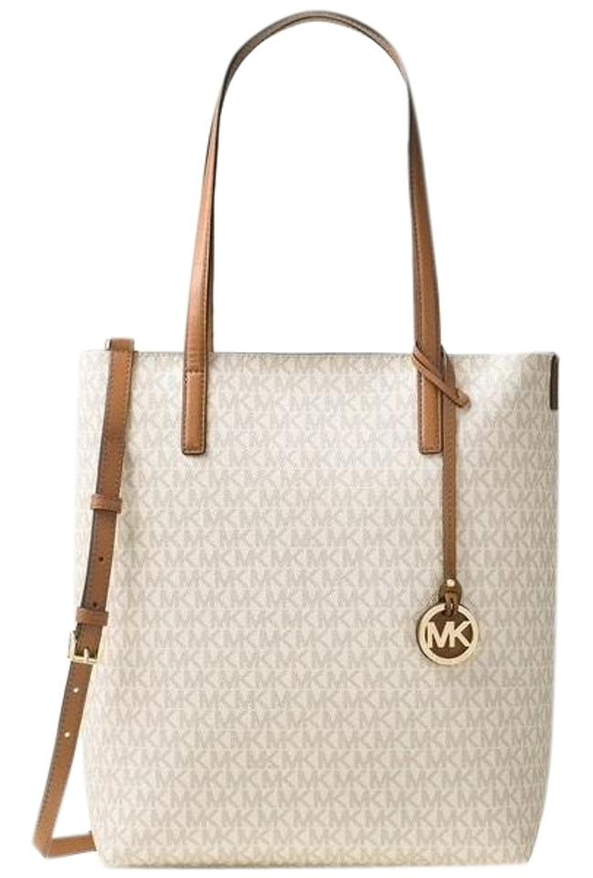 e9aaa5171770 Michael Kors Haley Convertible Pouch Vanilla Coated Canvas with Leather  Handle and Strap Tote