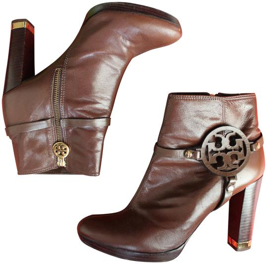 Preload https://item2.tradesy.com/images/tory-burch-brown-leather-ankle-bootsbooties-size-us-11-regular-m-b-23755556-0-1.jpg?width=440&height=440